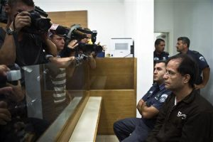 Iranian-Belgian citizen Mansouri sits in a courtroom at the magistrate's court in Petah Tikva