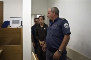 Iranian-Belgian citizen Mansouri enters a courtroom at the magistrate's court in Petah Tikva