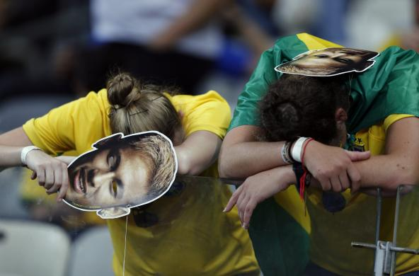 Fans of Brazil react after their loss to Germany in their 2014 World Cup semi-finals at the Mineirao stadium in Belo Horizonte