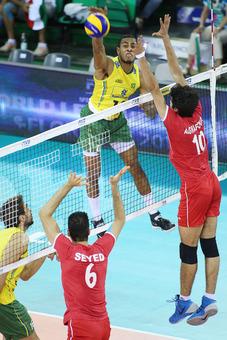 Ricardo Lucarelli (left) of Brazil spikes against Ghafour