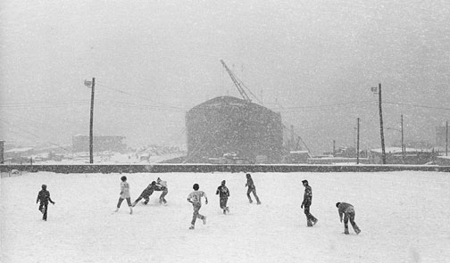 boys-playing-football-snow